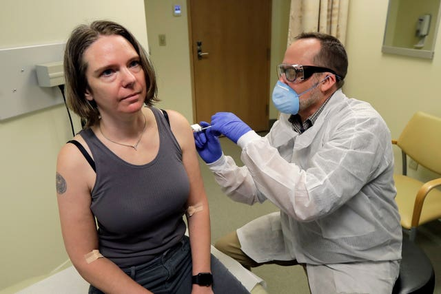 A pharmacist gives Jennifer Haller, left, the first jab in the first-stage safety study clinical trial (Ted S. Warren/AP)