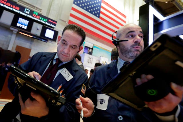 Traders work on the floor of the New York Stock Exchange (Richard Drew/AP)