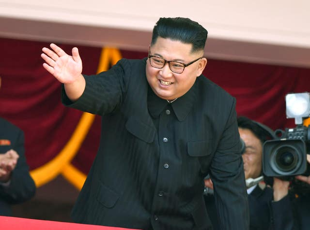 North Korean leader Kim Jong Un waves during the parade