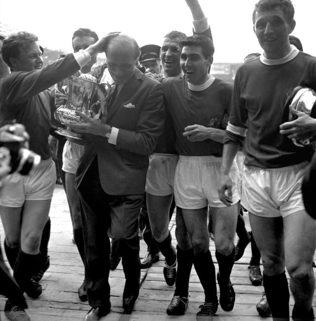 Tony Dunne (second right) enjoyed a glittering career under Sir Matt Busby