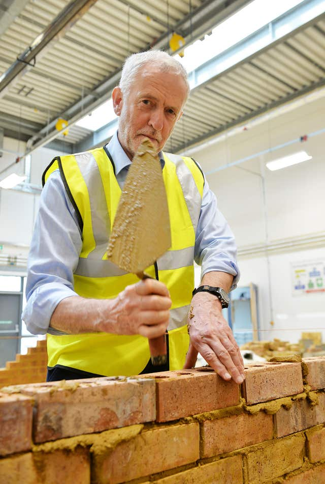 Labour leader Jeremy Corbyn has a go at bricklaying