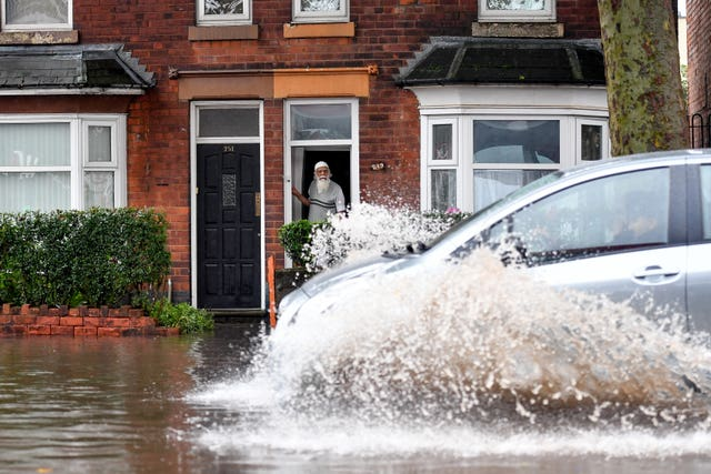 Car drives through floodwater
