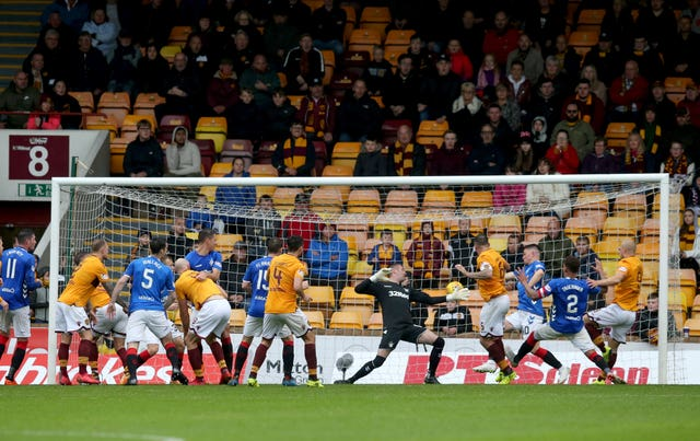 Peter Hartley scores Motherwell's last-gasp equaliser against Rangers
