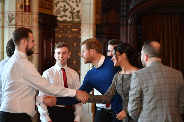 Prince Harry and Meghan Markle meet Only Boys Aloud (Ben Birchall/PA)