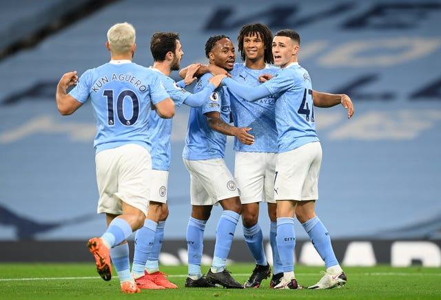 Sergio Aguero, left, joins the celebrations after Raheem Sterling, centre, scored against Arsenal