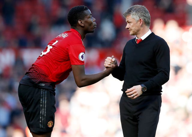 Manchester United manager Ole Gunnar Solskjaer, right, wants Paul Pogba, left, to stay at Old Trafford for one more season
