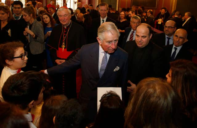 The Prince of Wales speaks to members of the Iraqi Chaldean Catholic community children's choir in 2015 (Alastair Grant/PA)