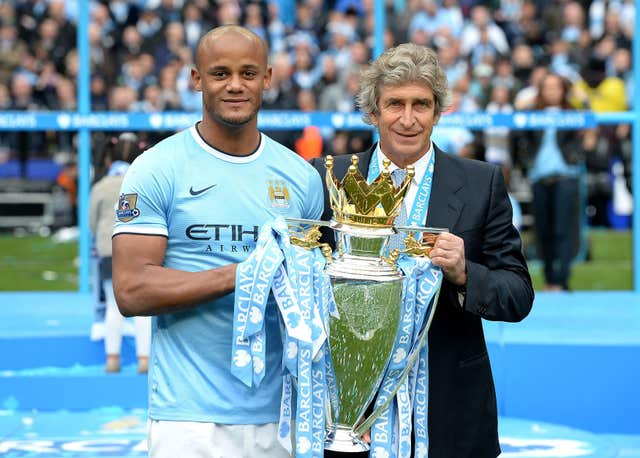 Kompany pictured with former City boss Manuel Pellegrini after winning the 2014 Premier League title