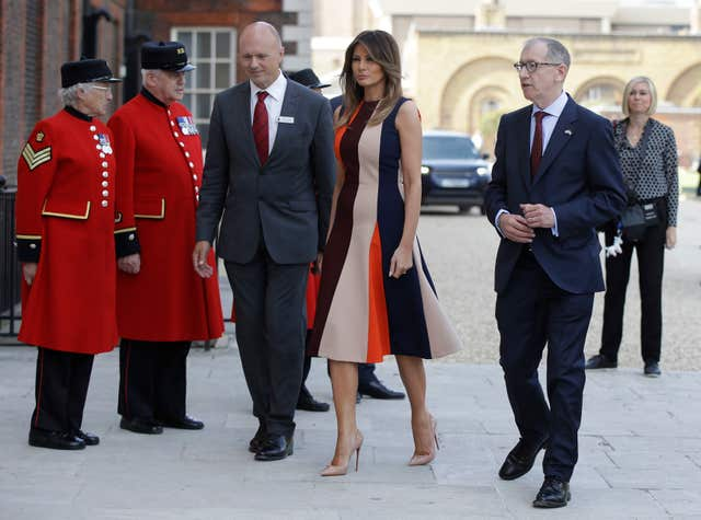 The US First Lady Melania Trump, accompanied by Philip May (right) the husband of Prime Minister Theresa May, arrives at the Royal Hospital, Chelsea, London.