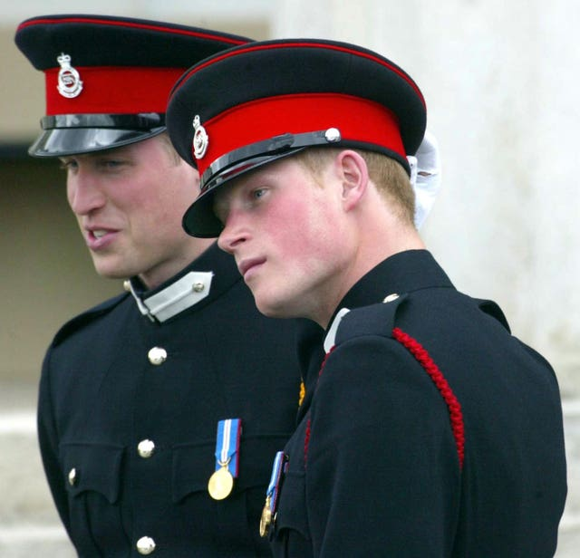 Prince William and Prince Harry at Sandhurst Royal Military Academy's Sovereign's Parade in 2006 (PA)