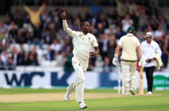 Jofra Archer celebrates taking the wicket of Australia's David Warner