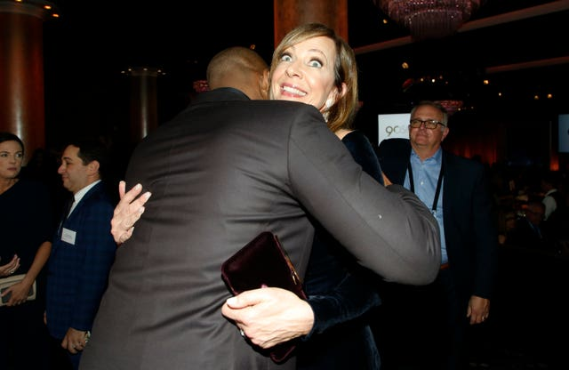 Kobe Bryant, left, embraces Allison Janney