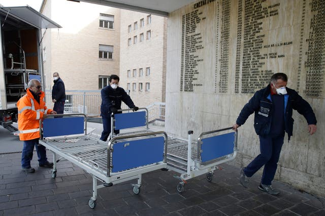 Personnel carry new beds inside the hospital in Codogno, near Lodi in northern Italy