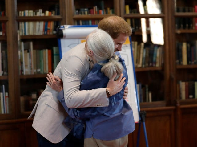 The Duke of Sussex pictured hugging Dr Jane Goodall at a recent event, has interviewed the chimpanzee expert for British Vouge. Kirsty Wigglesworth/PA Wire