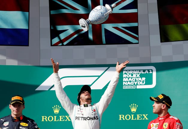 Lewis Hamilton celebrates his dramatic Hungarian Grand Prix victory after he overtook Max Verstappen late on at the Hungaroring
