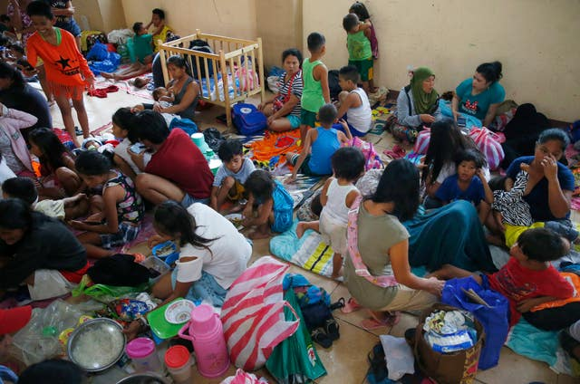 Residents living along the coastal community of Baseco, Philippines, seek temporary shelter at an evacuation centre in the onslaught of Typhoon Mangkhut