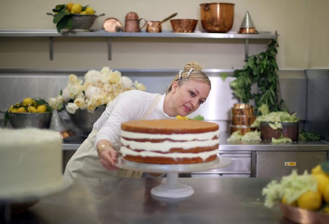 Claire Ptak puts finishing touches to the cake for the royal wedding (Hannah McKay/PA)