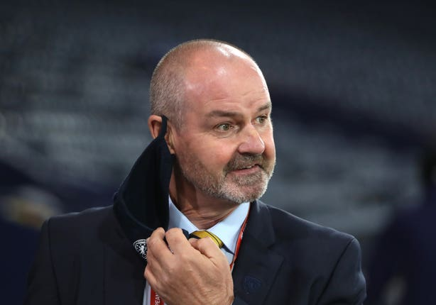 Steve Clarke removes his face covering
