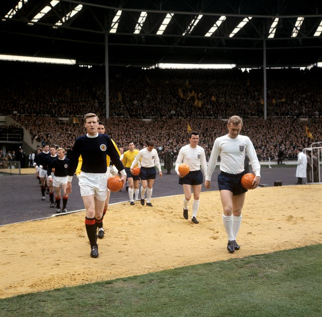 Billy McNeill (Scotland) and Bobby Moore (England)