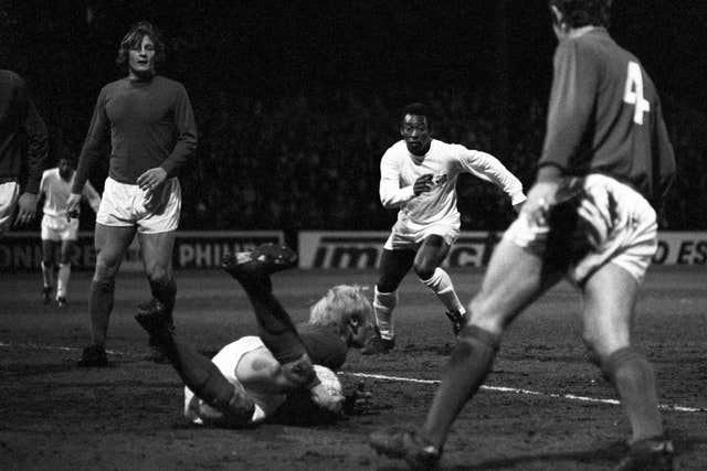 Fulham goalkeeper Peter Mellor dives at the feet  of Pele to smother the ball