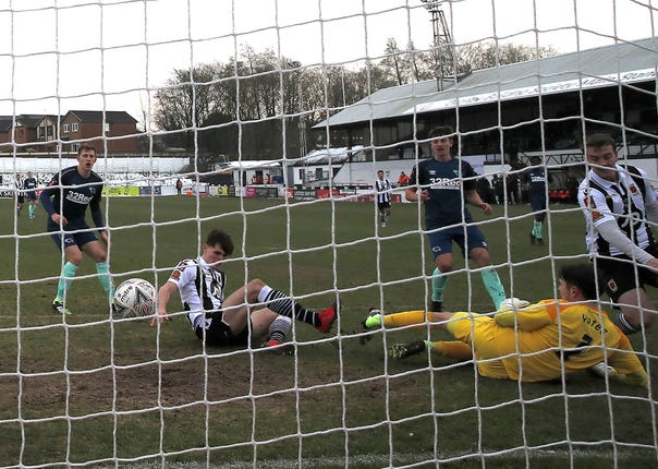 Chorley's Mike Calveley, second left, scores his side's second goal in their third-round win against Derby