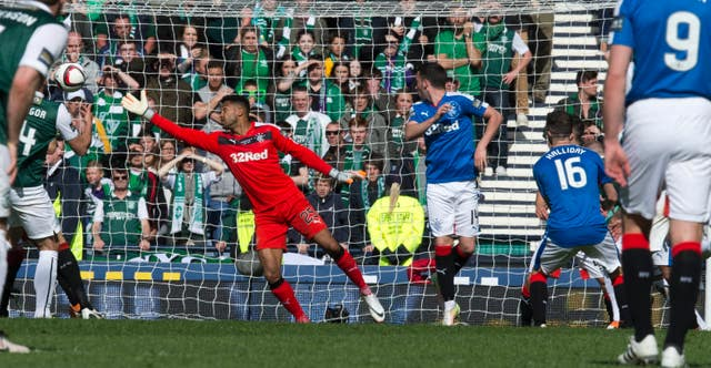 Hibernian's David Gray (obscured) scores against Rangers