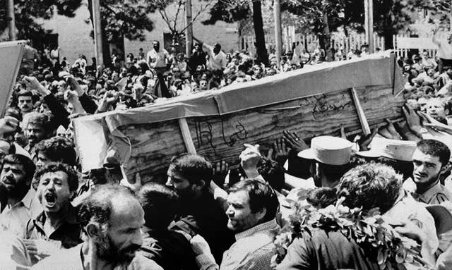 Iranian mourners carry one of 72 coffins in Tehran in 1988