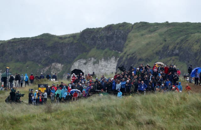 Crowds watch Northern Ireland's Rory McIlroy on the 7th tee during day two of The Open Championship 2019 at Royal Portrush Golf Club