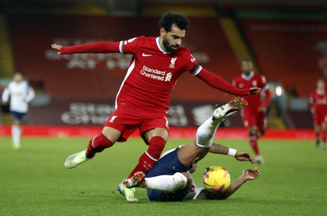Liverpool forward Mohamed Salah skips past a Tottenham defender