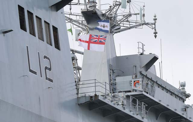 The Ensign is lowered at the decommissioning ceremony for HMS Ocean at HMNB Devonport in Plymouth (Andrew Matthews/PA)
