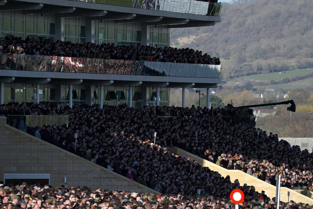 Crowds in the grandstand during Gold Cup day at Cheltenham