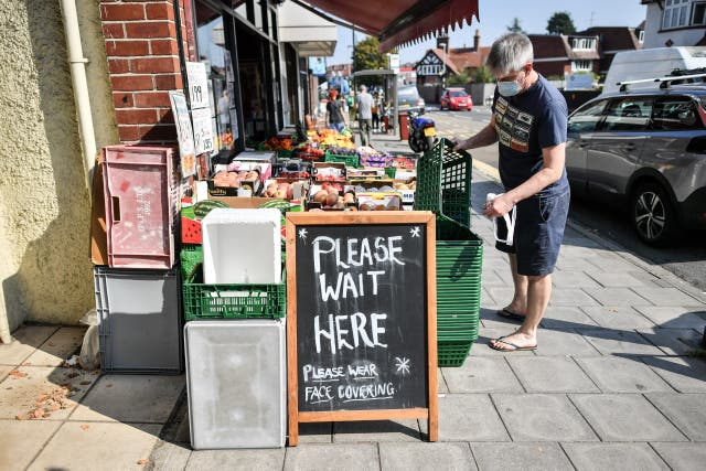 Signage outside a greengrocers advising shoppers to wear face coverings, on the High Street in Henleaze, Bristol, some six months on from the evening of March 23 when Prime Minister Boris Johnson announced nationwide restrictions