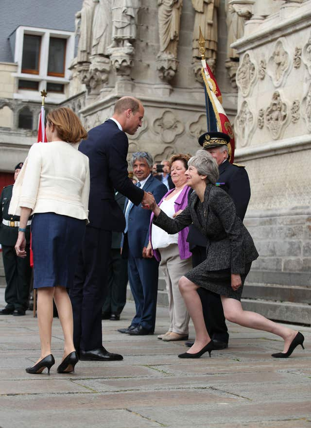 Theresa May curtsying to the Duke of Cambridge