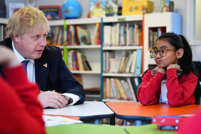 Foreign Secretary Boris Johnson sits with pupils on a visit to St Leonard's Church of England Primary Academy in Hastings (Dylan Martinez/PA)
