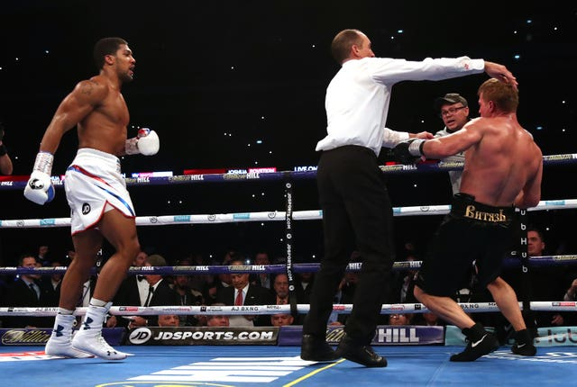 Anthony Joshua stepped it up in the seventh and knocked his opponent down