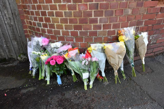 Floral tributes left outside 109 Cowick Lane, Exeter, where the bodies of twins Dick and Roger Carter, aged 84, were discovered (Ben Birchall/PA Wire)