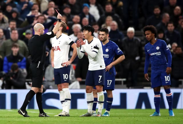 Anthony Taylor shows Son Heung-min a red card for kicking Antonio Rudiger in a separate incident