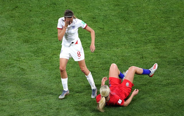 Scott, left, and Lindsey Horan, right, come together in midfield