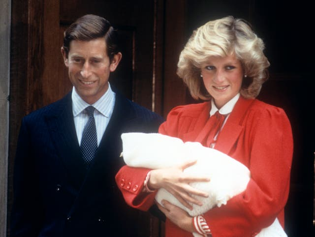 Newborn Prince Harry with his parents