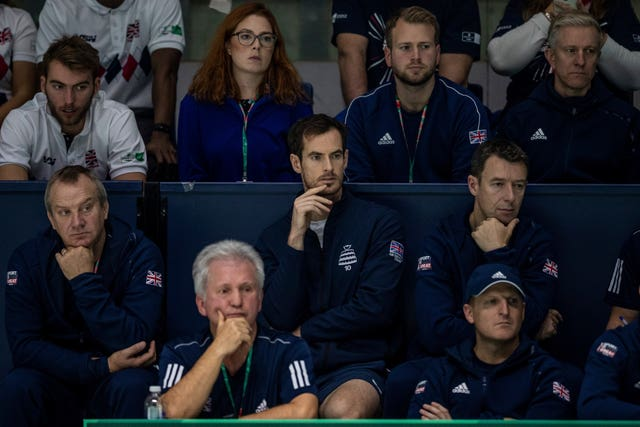 Andy Murray, centre, watched from the stands on Thursday
