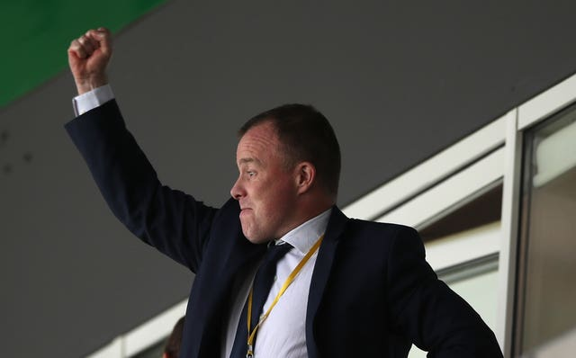 Leeds managing director Angus Kinnear celebrated wildly in the stand