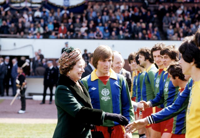 Kenny Dalglish introduces The Queen to members of the Glasgow Select XI