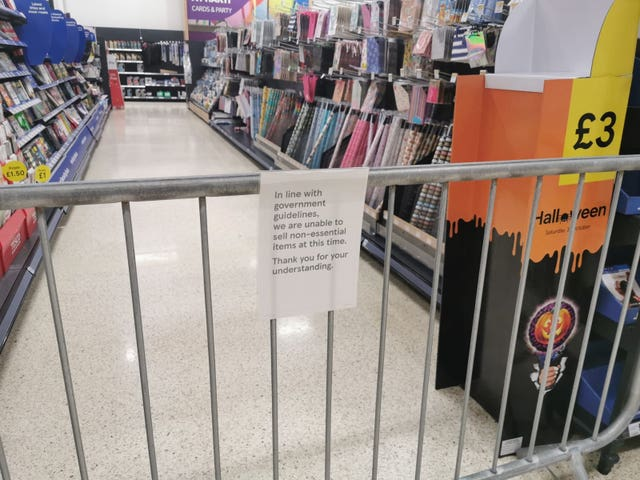 A notice informing customers of the sales of non-essential products at a Tesco Extra store in Pengam Green, Wales