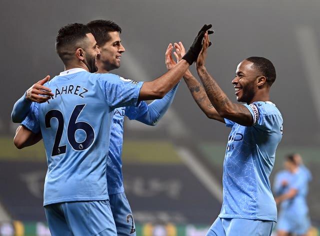 Goalscorers Riyad Mahrez, left, and Raheem Sterling, right, celebrate