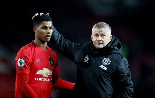 Ole Gunnar Solskjaer, right, will have to make do without Marcus Rashford over the coming weeks