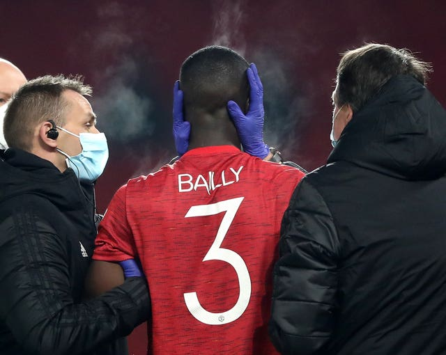 Eric Bailly was forced off with a head injury