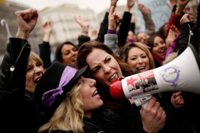 Women make their voices heard during a protest at Sol square on International Women's Day in Madrid (Francisco Seco/AP)