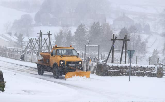 Roads are cleared in Nenthead, Cumbria - one of several areas in the north to wake to snow (Owen Humphreys/PA)