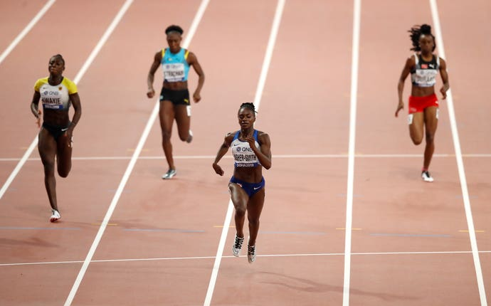 Dina Asher-Smith (centre) powered through to the final