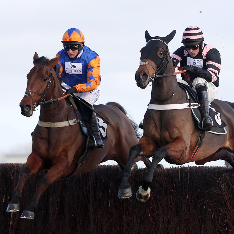Knocknanuss (left) on his way to winning at Newbury